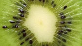 a view : Extreme close-up of kiwi cut Stock Footage