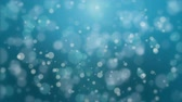 translúcido : Beautiful glowing dark turquoise blue bokeh background with floating light particles. Stock Footage