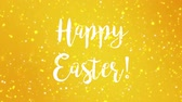 húsvét : Sparkly Happy Easter greeting card video animation with handwritten text and colorful glitter particles flickering on yellow background. Stock mozgókép
