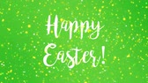 zmartwychwstanie : Sparkly Happy Easter greeting card video animation with handwritten text and colorful glitter particles flickering on green background.