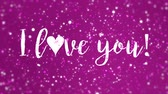 san valentin corazones : Romantic animated magenta pink Valentines Day greeting card with I love you handwritten text and sparkling light particles.