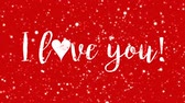 san valentin corazones : Sparkly red animated Valentines Day greeting card with I love you handwritten text and flickering light particles.
