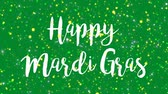 terça feira : Sparkly green Happy Mardi Gras greeting card video animation with handwritten text and flickering colorful glitter light particles.
