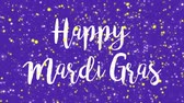 terça feira : Sparkly purple Happy Mardi Gras greeting card video animation with handwritten text and falling colorful glitter light particles.