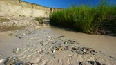 lamacento : Muddy waters flow through Sage Creek in Badlands National Park of South Dakota Stock Footage