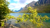 Mountains rise steeply from the shoreline of Kintla Lake in Glacier National Park Stock Footage