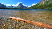 Mount Sinopah rises over Two Medicine Lake in Glacier National Park Stock Footage