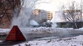 gutter system : Steam on winter street from broken water system Stock Footage