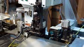 技術 : Manufacturing. View of modern machine processes wire, close-up