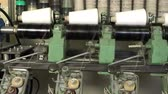 objem : White thread spools at automatic rewinding machine