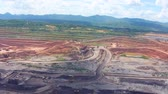 coalmining : Aerial view shot for Mining dump trucks working in Lignite coalmine lampang thailand Stock Footage