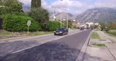 automobilista : Bar, Montenegro, April, 17, 2016: Road traffic in Montenegro. Police car goes towards the camera. Sky is blue, its a sunny day. Mountains on the background