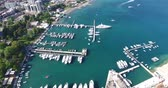 watercraft : Aerial view of Budvas marina with its boats, yachts and ships. Flight above the marina and the waterfront moored at the pier Stock Footage