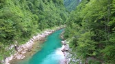 szmaragd : Flight of a quadcopter over a mountains river canyon. It is clear that it?s clear that it?s transparent.