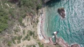 Drone flies above the coastline of the Adriatic sea, southern Montenegro, in a sunny summer day. Water in the sea is turquoise, clean and clear Videos