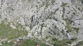 szmaragd : Aerial shot of huge mountains in Boko-Kotor bay, Montenegro, on a sunny summer day. Sky is blue