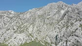 Aerial shot of huge mountains in Boko-Kotor bay, Montenegro, on a sunny summer day. Sky is blue