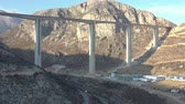 dálnice : Aerial shooting of the construction of Montenegros first expressway. Autobahn highway between Montenegro and Serbia, which will connect the South and North of the country. Mountain bridge in the north of Montenegro and a deep canyon of the mountain river Dostupné videozáznamy