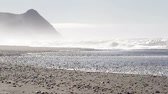 beautiful beach with dramatic changes in the landscape and a mist or fog clinging to the mountains in the Oregon coast