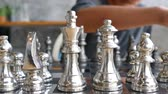 xeque mate : concept of Man playing silver chess