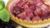 recipe : Freshly baked rhubarb tartlet with honey ice cream and cherry coulis