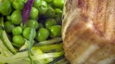 braised dishes : Grilled Butter fish steak with zucchini-pea stew braised in white wine Stock Footage
