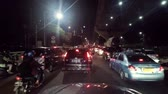 casablanca : JAKARTA, Indonesia. August 14, 2017: Video footage of traffic jam on the Casablanca road with cars and motorcycle moving slowly at night Stock Footage