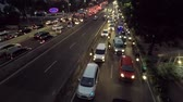 casablanca : JAKARTA, Indonesia. August 14, 2017: Video footage of traffic jam on the highway with crowded cars and motorcycle at night in Jakarta