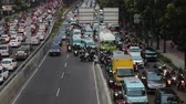 casablanca : JAKARTA, Indonesia. August 14, 2017: Video footage of crowded cars and motorcycle on traffic jam in Casablanca street at Jakarta
