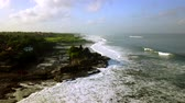 tanah lot : Beautiful aerial landscape footage of Tanah Lot Temple with frothy wave and ocean view in Bali, Indonesia. Shot in 4k resolution