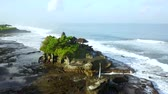 tanah lot : Aerial footage of beautiful landscape above Tanah Lot Temple with tourists and frothy wave in Bali, Indonesia. Shot in 4k resolution