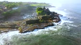 tanah lot : Beautiful aerial landscape footage of Tanah Lot Temple with frothy wave from a drone flying around the temple in Bali, Indonesia. Shot in 4k resolution