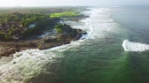 tanah lot : Top view footage of beautiful landscape in Tanah Lot Temple with frothy wave at Bali, Indonesia. Shot in 4k resolution