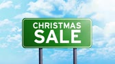 Christmas Sale Concept. Timelapse footage of Christmas Sale text on green road sign with moving clouds