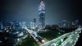 JAKARTA, Indonesia. October 30, 2017: Timelapse footage of skyscraper building and highway in Kuningan central district business at night. Shot in 4k resolution Vidéos Libres De Droits