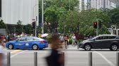 Singapore - November 27, 2017: Stop motion of crowded people cross the Orchard Road Singapore. Shot in 4k resolution