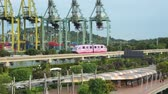 Singapore - November 28, 2017: Video footage of Sentosa Express Monorail toward Sentosa Island with Singapore container port on the background Vidéos Libres De Droits