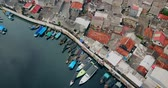 побережье : Aerial landscape of fishing village with fishing boats and slum houses settlement near the Sunda Kelapa port in North Jakarta, Indonesia. Shot in 4k resolution