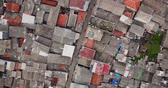 bando : Aerial view from a drone flying above an alley at slum urban settlement in Jakarta city, Indonesia. Shot in 4k resolution