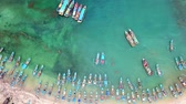 turkus : Beautiful aerial shot of traditional fisherman boats anchoring in a row at ujung Genteng beach, Sukabumi, West Java, Indonesia