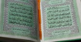 oração : JAKARTA - Indonesia. April 18, 2018: Closeup of Koran or holy book of Muslims with pointer stick in the mosque open for prayers. Shot in 4k resolution