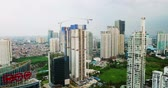 JAKARTA - Indonesia. April 11, 2018: Aerial footage of apartment buildings construction in Jakarta capital city from a drone flying down. Shot in 4k resolution