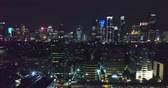 JAKARTA - Indonesia. April 11, 2018: Stunning aerial cityscape in Jakarta with skyscrapers and sparkle beautiful night lights. Shot in 4k resolution
