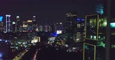 Beautiful aerial panorama of Jakarta central business district at night with sparkle beautiful night lights. Shot in 4k resolution