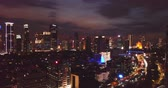 JAKARTA - Indonesia. April 11, 2018: Beautiful aerial Jakarta cityscape with exotic sky and skyscrapers view at night. Shot in 4k resolution Vidéos Libres De Droits