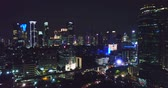 Beautiful aerial panorama of Jakarta downtown with skyscrapers and stunning night lights. Shot in 4k resolution