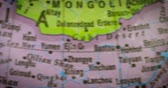 mongolia : JAKARTA - Indonesia. February 21, 2018: Closeup of Mongolia country map on the globe. Mongolia is a landlocked unitary sovereign state in East Asia. Shot in 4k resolution