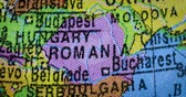 romanya : JAKARTA - Indonesia. February 21, 2018: Closeup of country map of Romania region on the globe. Romania is a southeastern European country. Shot in 4k resolution Stok Video