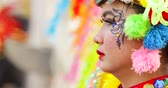 participante : JAKARTA, Indonesia - May 31, 2018: Young female participant of Asian Games 2018 Parade wearing traditional costume and colorful accessories. Shot in 4k resolution
