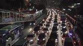 abrigo : JAKARTA, Indonesia - June 22, 2018: Aerial view of automobile congestion in the Central Business District of Jakarta at night Stock Footage